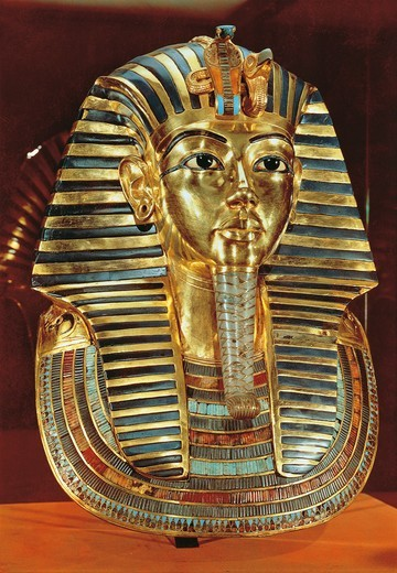 Burial mask of gold, lapislazuli, obsidian and turquoises of pharaoh Nebkheperura Tutankhamen (1341-1323 B.C.), 18th dynasty, New Kingdom : Stock Photo