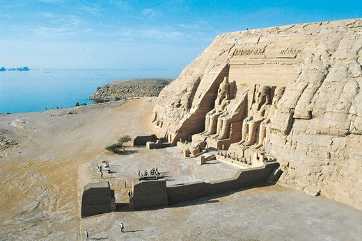 Nubian monuments at Abu Simbel. Great Temple of Ramses II and Lake Nasser in the background : Stock Photo