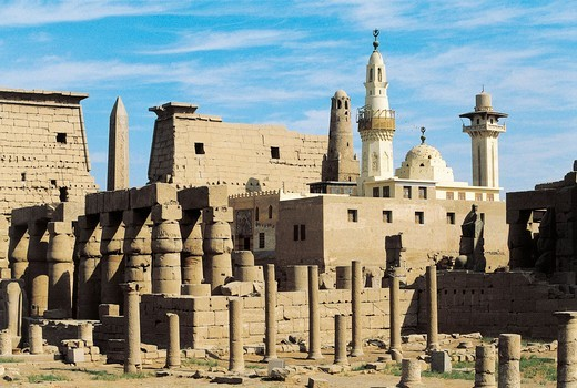 Egypt, Ancient Thebes Luxor, Temple of Amon, Ruins and pylon of Ramses II in background : Stock Photo