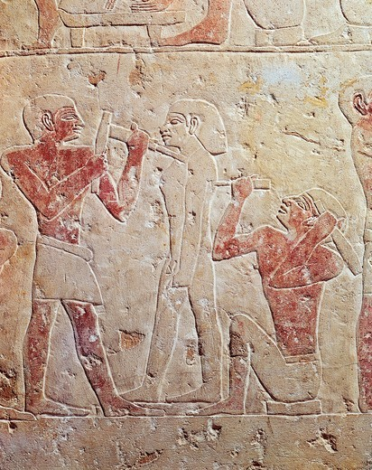 Relief depicting sculptors working at statue, from Saqqara, Egypt : Stock Photo