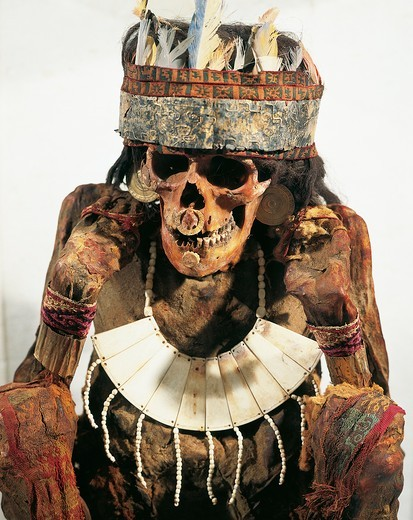 Stock Photo: 1788-16410 Mummy of woman of Necropolis decorated with gold and bone jewels and feather headdress, circa 200 B.C.