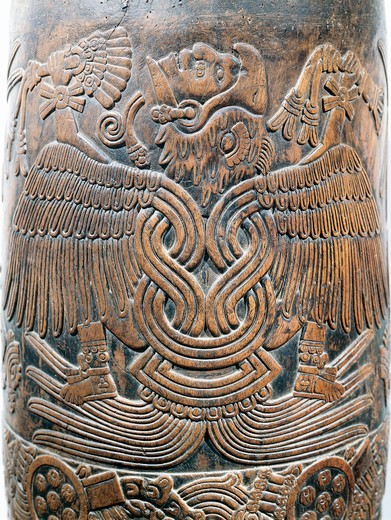 Wooden drum with relief depicting eagle-knight warrior, from Mexico : Stock Photo