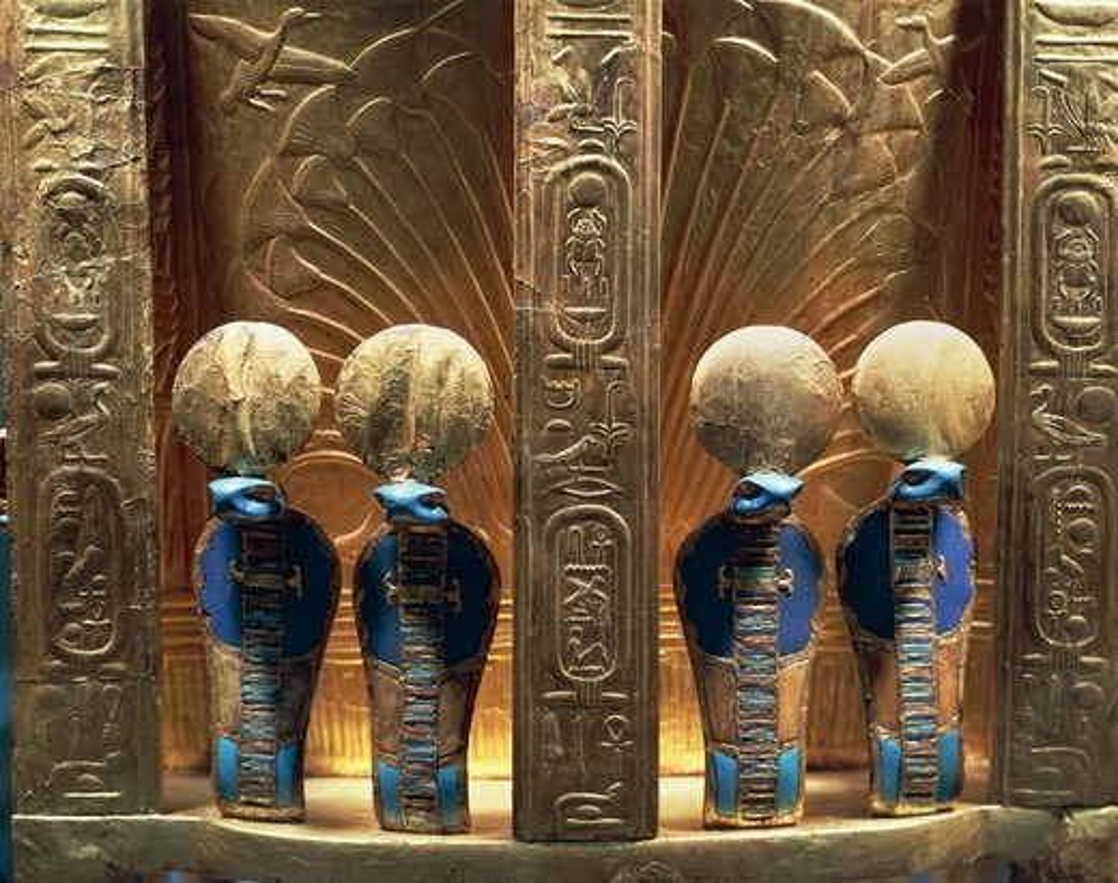 Treasure of Tutankhamen. Throne of Tutankhamen. Detail, four uraei crowned with sun discs, New Kingdom, Dynasty XVIII : Stock Photo