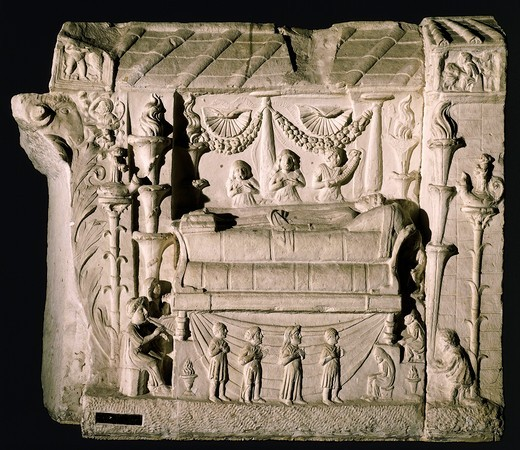 Relief depicting a lamentation over a deceased woman lying on a bed, with four candelabra, two mourners, a woman crowning her, a flutist and some figures in prayer. From the Tomb of the Haterii, Centocelle, Rome : Stock Photo