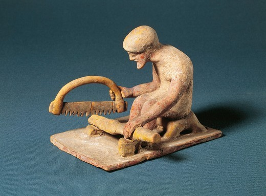 Greek fictile figurine of carpenter at work, from Boeotia, Greece, 5th Century B.C. : Stock Photo