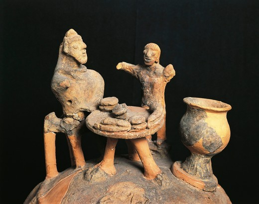 Detail of Etruscan terracotta cinerary vase decorated with applied figurines at banquet table, from Montescudaio, Pisa Province, Italy, 6th Century B.C. : Stock Photo