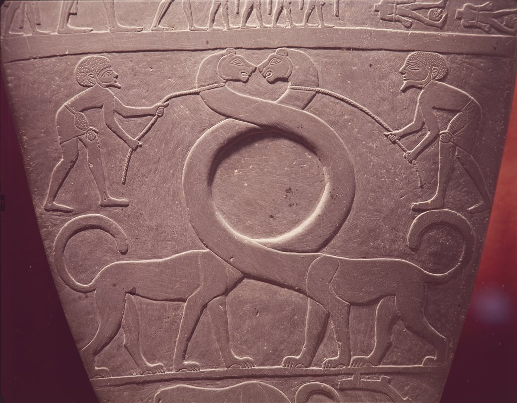 Stock Photo: 1788-1714 Egyptian Civilization. 3rd millennium BC. Slate Narmer palette. Detail of relief on obverse side: men tie intertwining necks of felines