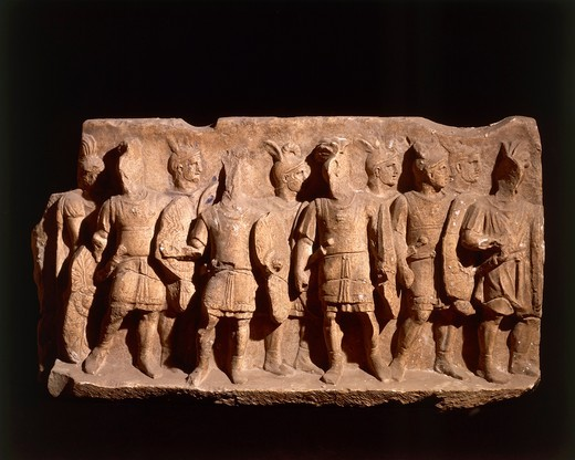 Relief depicting legionaries wearing regulation armor from Cumae, Campania region, Italy, Roman civilization. : Stock Photo