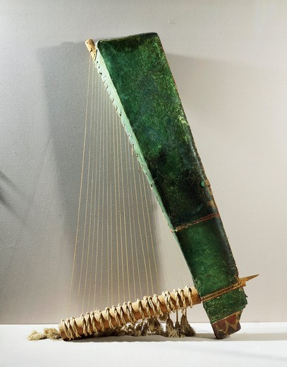 Stock Photo: 1788-17407 Musical instrument: wood and copper triangular harp, Late Period