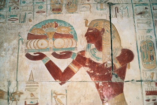 Egypt, Abydos, Temple of pharaoh Seti I, Osiris chapel, painted relief depicting offering bearer : Stock Photo