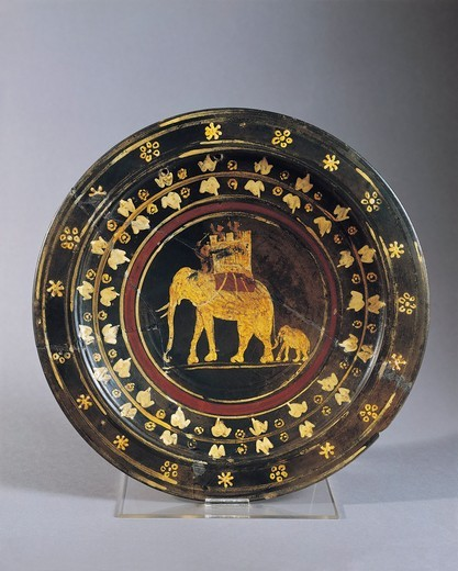 Plate decorated with war elephant figures from Capena, Rome Province, Italy : Stock Photo