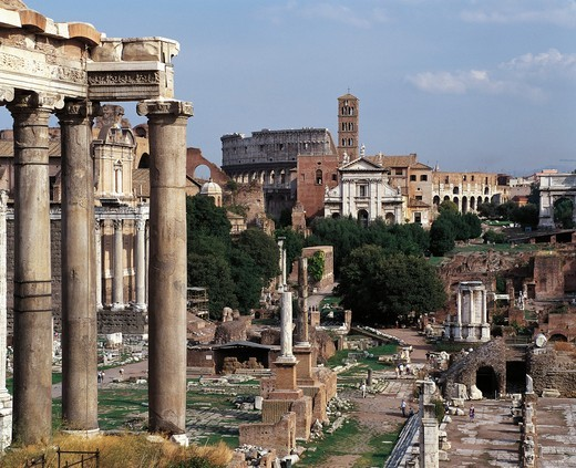 Italy, Latium region, Rome, Imperial Fora, Temple of Saturn, Via Sacra, Temple of Vesta and church of Santa Francesca Romana in background : Stock Photo