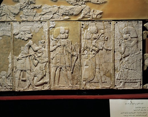 Ivory panel depicting prince praying, man with lion cub and war scenes, from Ugarit, Ras-Shamra, Syria : Stock Photo