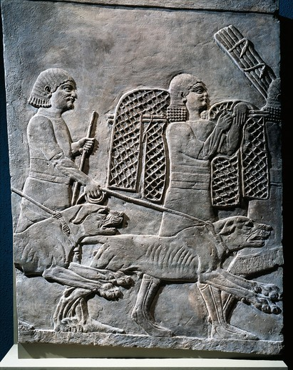 Relief of hunting scene with dogs and traps, from Nineveh : Stock Photo