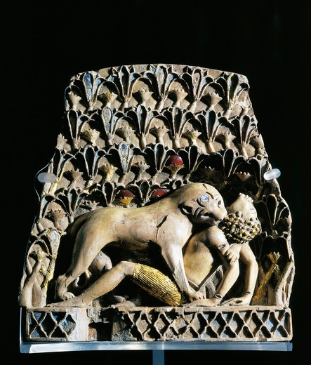 Furniture ornament depicting lioness attacking African boy, ivory inlaid with lapis lazuli, from Nimrud, Iraq : Stock Photo