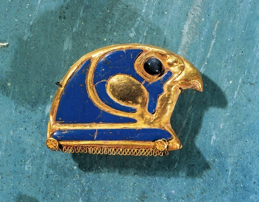 Gold and lapis lazuli jewel representing the head of Horus : Stock Photo