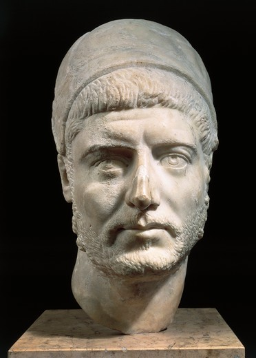 Marble head of winning charioteer, known as Barbarian Prince, with leather helmet : Stock Photo