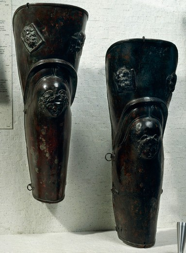 Pair of bronze jambs which belonged to gladiator of Thracian origin, decorated with reliefs depicting head of Gorgon, From Ercolano : Stock Photo