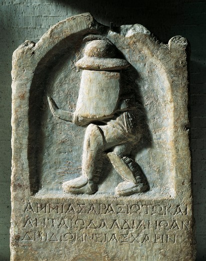 Funerary stone of gladiator of Thracian origin - Relief of gladiator with armour and engraving of Ammias of Araxios : Stock Photo
