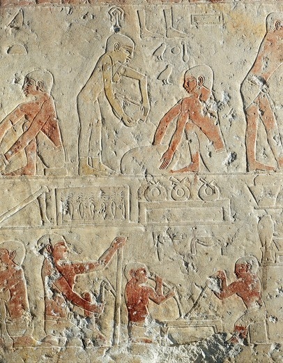 Reliefs from mastaba of Kemrehu, detail of metalworking and preparation of terracotta : Stock Photo