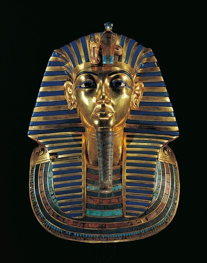 Golden funerary mask of Tutankhamen (1347/1338 b.c.) inlaid with lapis lazuli, obsidian and turquoise : Stock Photo