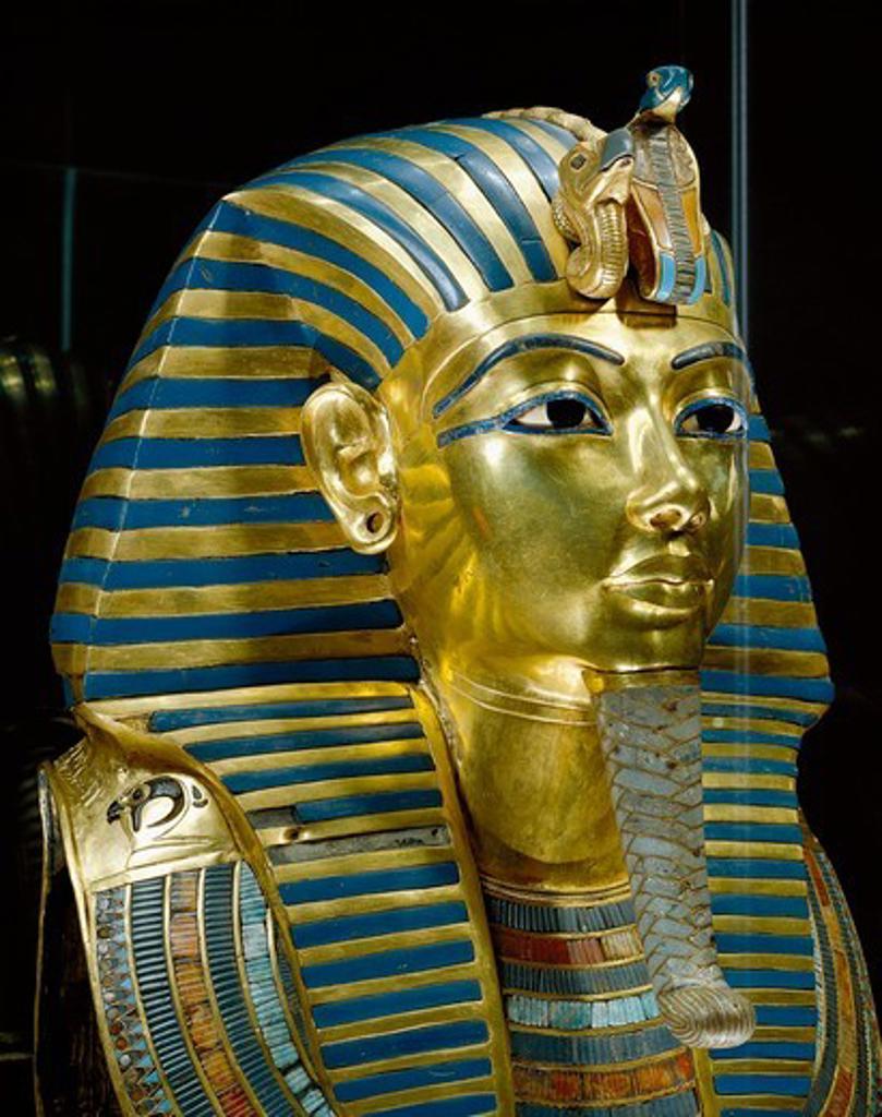 Stock Photo: 1788-20034 Golden funerary mask of Tutankhamen (1347/1338 b.c.) inlaid with lapis lazuli, obsidian and turquoise