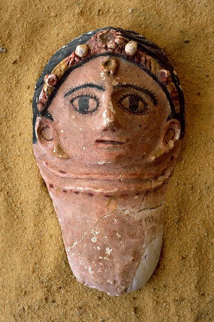 Egypt, Bahariya Oasis, Valley of the Golden Mummies, Terracotta funerary mask : Stock Photo