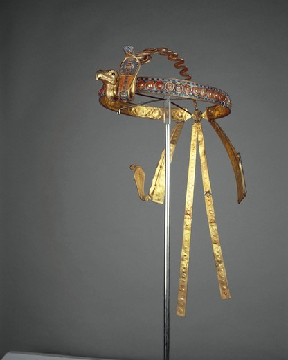 Treasure of Tutankhamen, royal diadem made of gold, precious stones and vitreous pastes, with Nekhbet (vulture) and Uadjet (cobra) on the forehead, deities of Upper and Lower Egypt from New Kingdom : Stock Photo