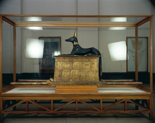 Stock Photo: 1788-20360 Treasure of Tutankhamen, wooden statue of jackal god Anubis upon a gilded chest from New Kingdom