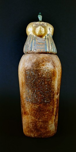 Alabaster and gold leaf canopic jar with human head, symbol of genius Imset, protector of liver, son of Horus from Tanis, tomb of Psusennes I, crypt : Stock Photo