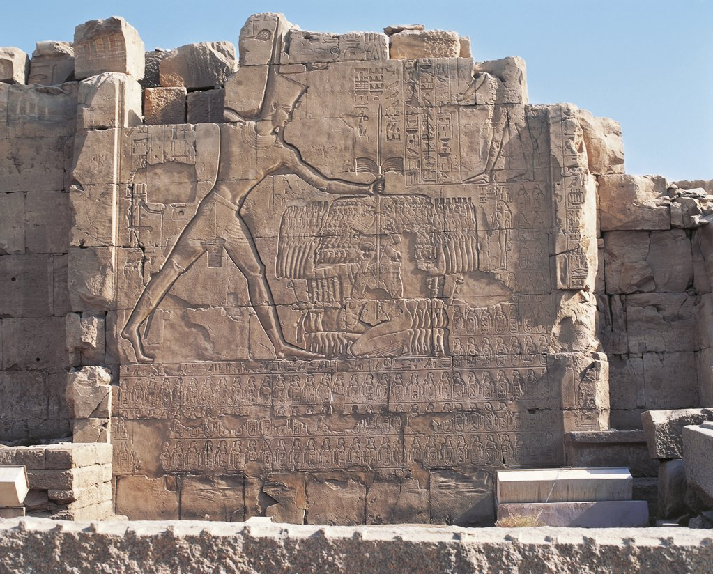 Egypt - Ancient Thebes (UNESCO World Heritage List, 1979). Karnak. Great Temple of Amon - Seventh pylon, relief of Thutmes III imprisoning the Hittites (1490-1436 b.C.) : Stock Photo