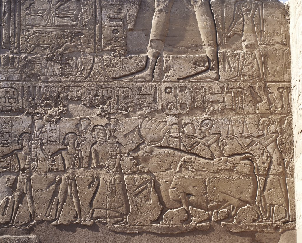 Egypt - Ancient Thebes (UNESCO World Heritage List, 1979). Luxor. Temple of Amon. Court of Ramses II, 1290-1224 BC. Relief of offer bearers to divinities from minerary districts : Stock Photo