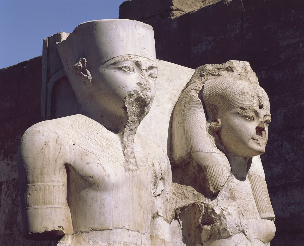Egypt - Ancient Thebes (UNESCO World Heritage List, 1979). Luxor. Temple of Amon. Limestone statuary group of Tutankhamen and Queen. New Kingdom, 18th Dynasty : Stock Photo