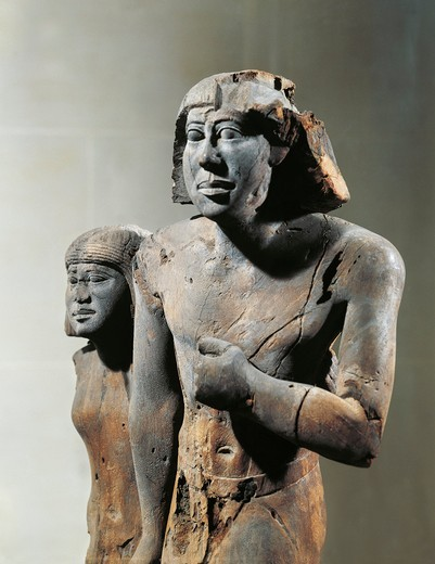 Egypt, Sculpture representing the civil servant Menfita with his wife, wood : Stock Photo