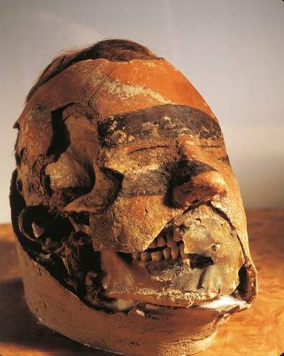 Funerary mask from a tomb found in the Oglahty mountains : Stock Photo