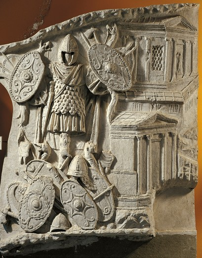 Five Good Emperors, Relief depicting the trophy of Dacian weapons: shields, helmets and battle-axes, plaster cast from the Trajan's Column, 113 A.D., imperial age : Stock Photo