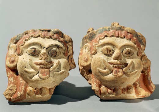 Ornamental elements representing two Gorgon heads, terracotta : Stock Photo