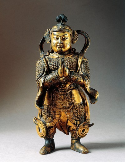 Statuette representing a divinity, Ming dynasty, gilded bronze : Stock Photo