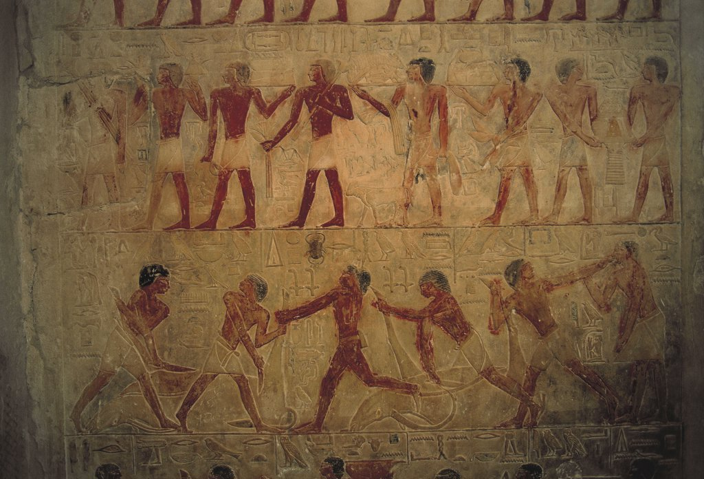 Egypt - Cairo - Ancient Memphis (UNESCO World Heritage List, 1979). Saqqara. Necropolis. Private funerary mastaba of vizier Ptahhotep, 5th Dynasty. Painted relief of offering bearers above and men butchering cattle below. : Stock Photo