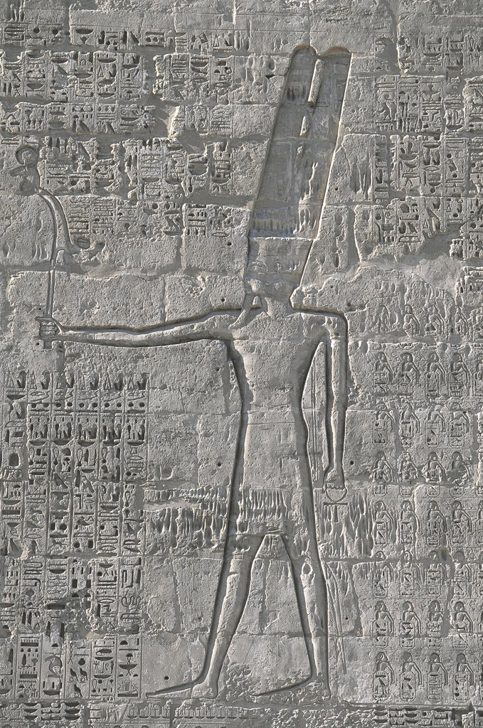 Stock Photo: 1788-2405 Egypt - Ancient Thebes (UNESCO World Heritage List, 1979). Luxor. Fortified temple of Ramses III at Medinet Habu. Relief of god Amon-Ra-Harakhty, 19th Dynasty