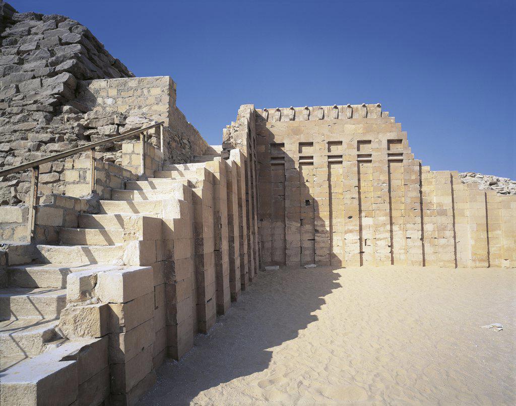Egypt - Cairo - Ancient Memphis (UNESCO World Heritage List, 1979). Saqqara. Funerary monument to king Djoser 'Step Pyramid', Old Kingdom, 5th Dynasty. Cobra Wall. : Stock Photo