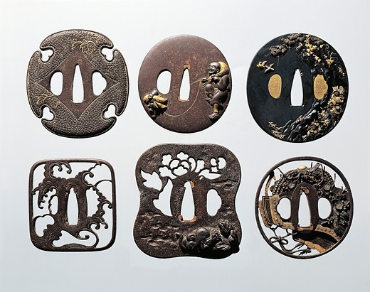 Tsuba (sword guards) in decorated, engraved and perforated iron : Stock Photo