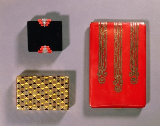 Stock Photo: 1788-26472 Goldsmith's art, France, 20th century. Black enamel, coral and diamond compact, by Cartier; enamelled gold box by Boucheron; lacquered silver gilt cigarette case.