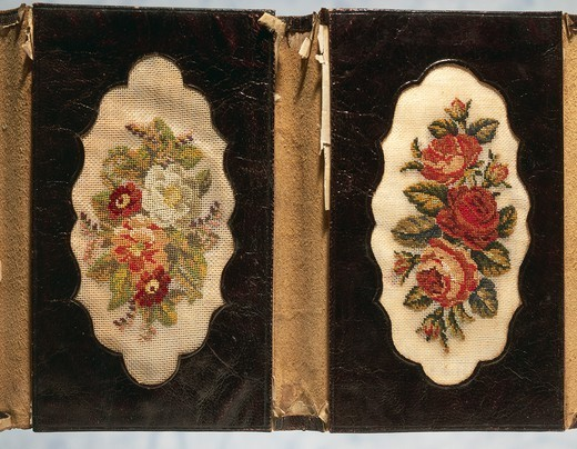 Stock Photo: 1788-26761 Embroidery, 19th century. Leather wallet with floral motifs,  embroidered in small stitch on linen.