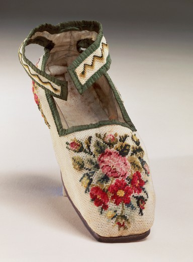 Stock Photo: 1788-26772 Embroidery, England 19th century.Children's shoe, embroidered in silk small stitch on linen, with floral and geometric motif.