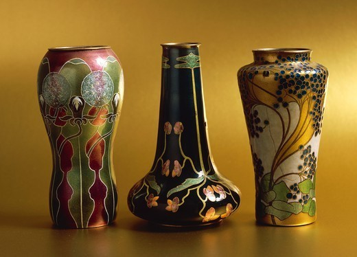 Goldsmith's art, 20th century. Enamelled metal vases by J.Pflugmacher, 1900-1901; at sides, vases by Else Unger; in the center, vase by Jutte Sika. : Stock Photo