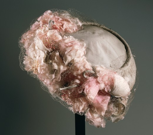 Stock Photo: 1788-28928 Fashion, 20th century. Women's grey synthetic chiffon hat with veil, ornamented with flowers, 'Mode Laurenti-Bologna-Modello', around 1950.