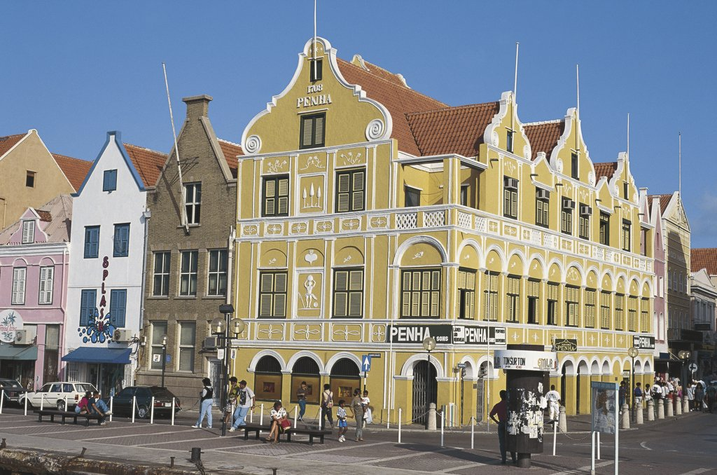 Group of people in front of buildings, Pehna House, Willemstad, Curacao, Netherlands Antilles : Stock Photo