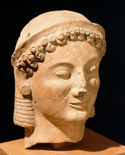 Female head, terracotta sculpture from Medma near Rosarno, Calabria, Italy. Ancient Greek civilization, Magna Graecia, 6th Century BC. : Stock Photo