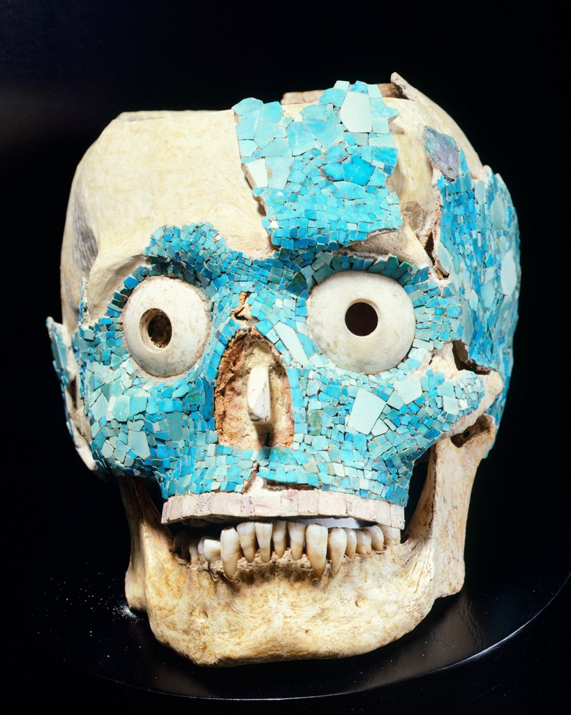 Stock Photo: 1788-41756 Skull decorated with turquoise from the Treasury of Tomb 7 in Monte Alban, Mexico, side view. Mixtec Civilization, post-classical period, 14th-15th Century.